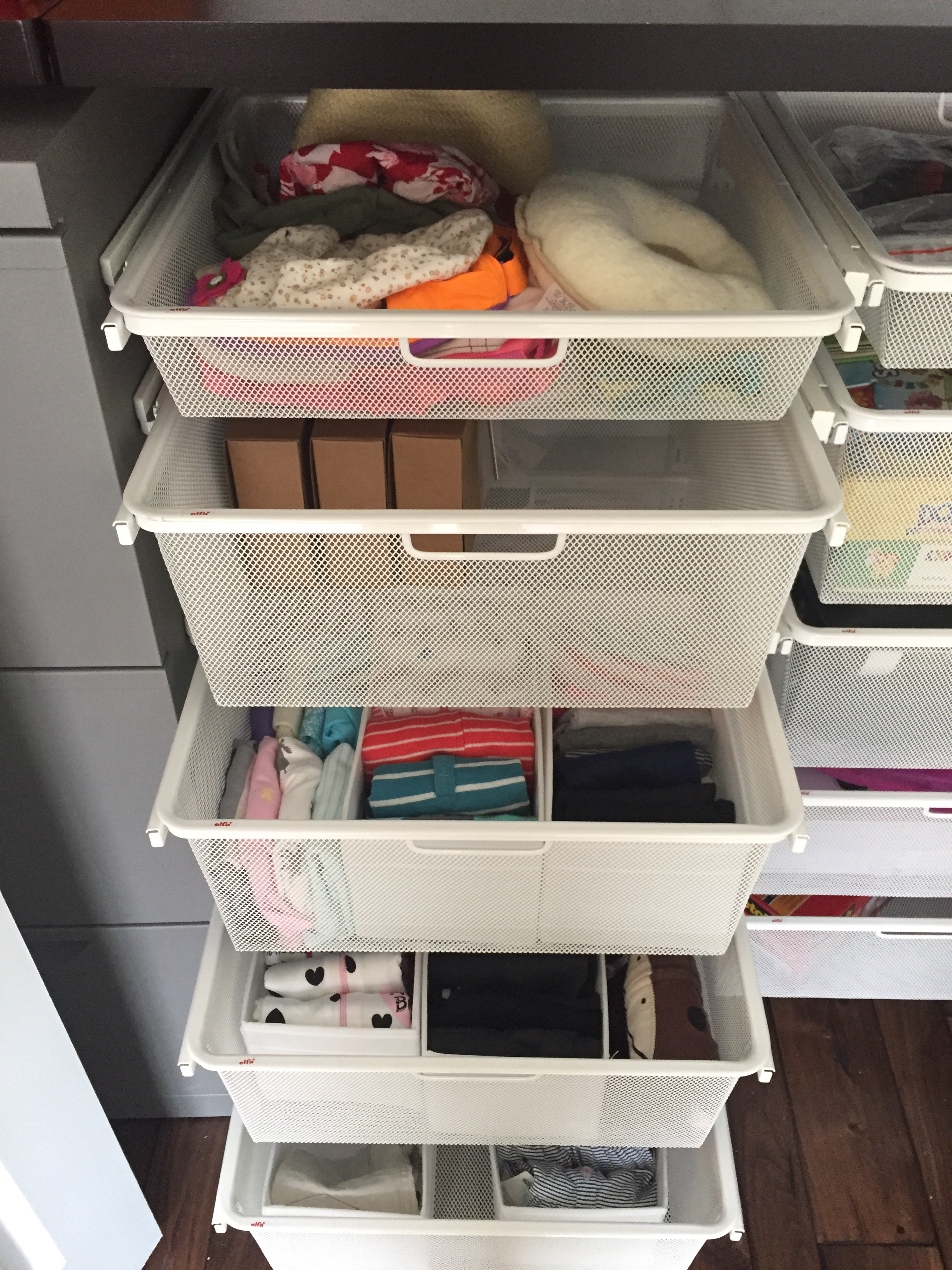 Office Supplies Are Sorted And Stored In The Colorful Open Bins (similar)  On The Left Side Of The Closet.